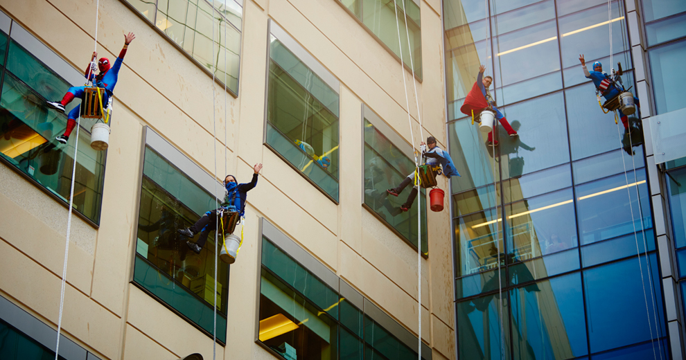 Window washers waving goodbye