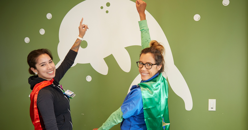 UCSF staff wearing superhero capes