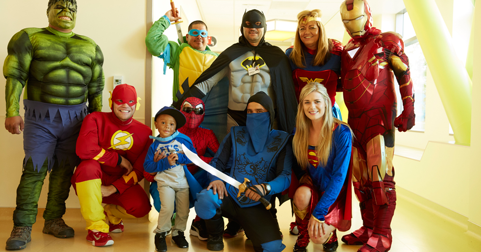 Group photo of children with superheroes